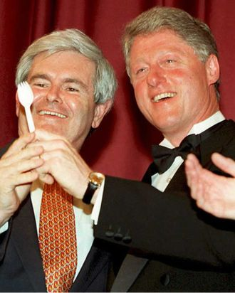 Before the annual dinner of the Radio and Television Correspondents Association in Washington 14 March 1995, US President Bill Clinton (R) poses with House Speaker Newt Gingrich as President Clinton shows Gingrich a plastic utensil known as a