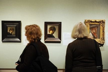 """People view self-portraits by Rembrandt van Rijn (L and C) and Edgar Degas (R) in the exhibition, """"Rembrandt and Degas: Portrait of the Artist as a Young Man"""" February 22, 2012 at the Metropolitan Museum of Art in New York."""