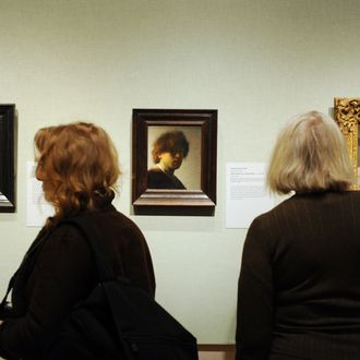 People view self-portraits by Rembrandt van Rijn (L and C) and Edgar Degas (R) in the exhibition,