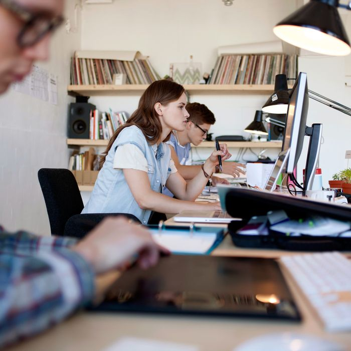 Young group of people working in creative loft design office