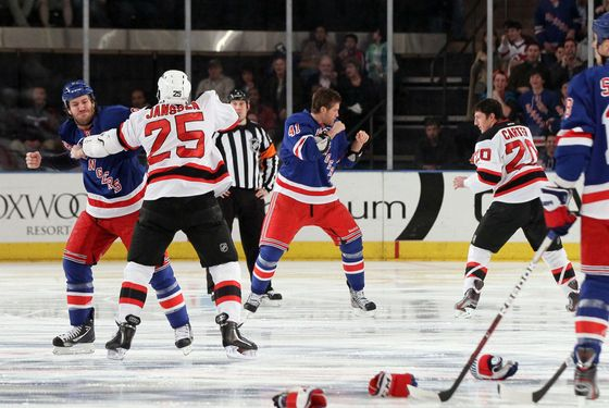 Brandon Prust (8) of the New York Rangers fights Cam Janssen (25) of the New Jersey Devils as Stu Bickel (41) of the New York Rangers fights Ryan Carter (20) of the New Jersey Devils three seconds into the game on Monday, March 19, 2012, at Madison Square Garden in New York. (Jim McIsaac/Newsday/MCT) (Newscom TagID: krtphotoslive539942) [Photo via Newscom]