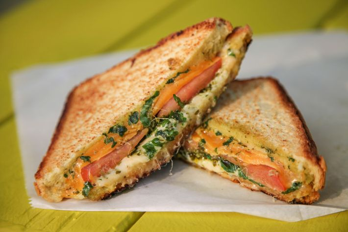 Cheddar and muenster grilled cheese, baby kale, housemade chimichurri sauce, and tomato.