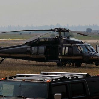 Authorities wait near a blackhawk helicopter at the Cascade Airport in Cascade, Idaho, Saturday, Aug. 10, 2013. About 150 federal agents have converged on Idaho's Frank Church River of No Return Wilderness in the search for 16-year-old Hannah Anderson and her suspected abductor, 40-year-old James Lee DiMaggio. (AP Photo/Robby Milo)
