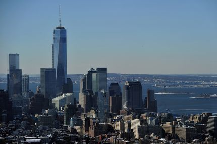 """View of One World Trade Center (L), also known as the """"Freedom Tower"""" and the Manhattan skyline looking south from the Empire State Building February 14, 2014 in New York. The Statue of Liberty (R) is visible in the distance in the New York Harbor. AFP PHOTO/Stan HONDA        (Photo credit should read STAN HONDA/AFP/Getty Images)"""