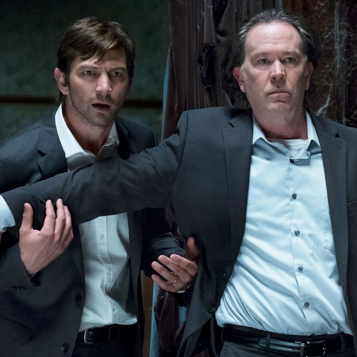 Michiel Huisman and Timothy Hutton in The Haunting of Hill House.