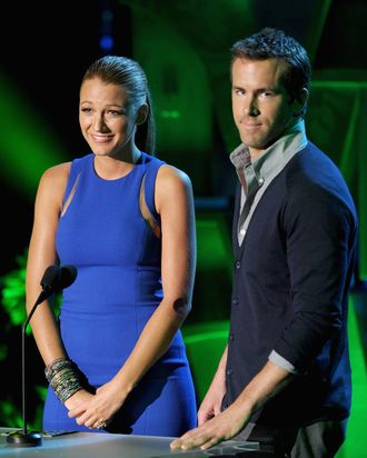 UNIVERSAL CITY, CA - JUNE 05: Actors Blake Lively (L) and Ryan Reynolds speak onstage during the 2011 MTV Movie Awards at Universal Studios' Gibson Amphitheatre on June 5, 2011 in Universal City, California. (Photo by Kevin Winter/Getty Images)