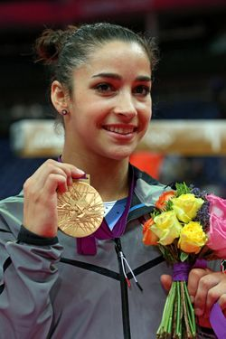 LONDON, ENGLAND - AUGUST 07:  Gold medalist Alexandra Raisman of the United States poses on the podium during the medal ceremony for the Artistic Gymnastics Women's Floor Exercise final on Day 11 of the London 2012 Olympic Games at North Greenwich Arena on August 7, 2012 in London, England.  (Photo by Ronald Martinez/Getty Images)