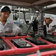 Workers inspect motherboards on a factory line at the Foxconn plant in Shenzen on May 26, 2010.  The Taiwanese boss of Apple manufacturer Foxconn headed to a sprawling factory in southern China where a spate of worker suicides have stoked anger about labour conditions. Terry Gou, the chairman of Foxconn's parent company Hon Hai Precision, flew into the booming city of Shenzhen aboard his private jet with travelling Taiwanese reporters, urging the media to see the factory for themselves.     AFP PHOTO / VOISHMEL (Photo credit should read VOISHMEL/AFP/Getty Images)