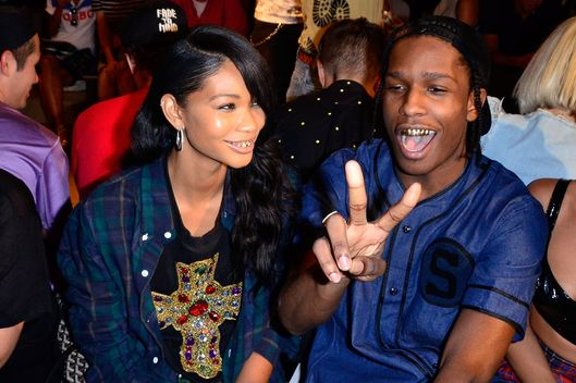 NEW YORK, NY - SEPTEMBER 11:  Model Chanel Iman (L) and recording artist ASAP Rocky attend the Jeremy Scott show during Spring 2014 MADE Fashion Week at Milk Studios on September 11, 2013 in New York City.  (Photo by Brian Killian/WireImage)