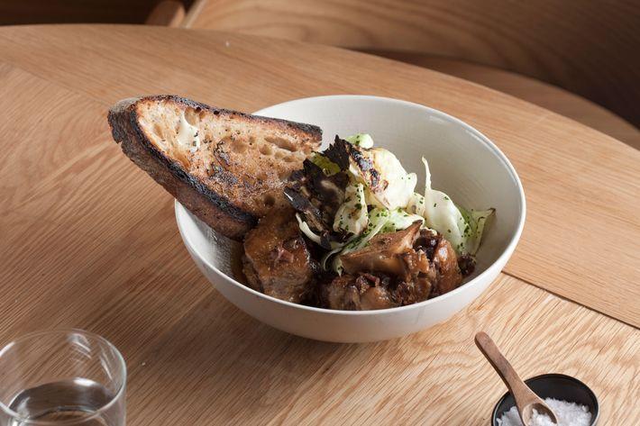 Glazed oxtails, marinated cabbage, sourdough. Photo: Melissa Hom