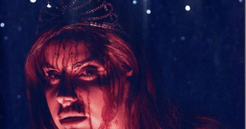 See Lana Del Rey Covered In Blood