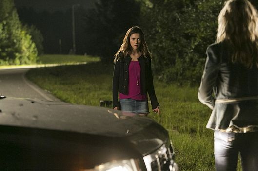 "The Vampire Diaries -- ""The More You Ignore Me, The Closer I Get"" -- Image Number: VD606a_0195.jpg -- Pictured (L-R): Nina Dobrev as Elena and Candice Accola as Caroline (back to camera) -- Photo: Tina Rowden/The CW -- ?'?? 2014 The CW Network, LLC. All rights reserved."