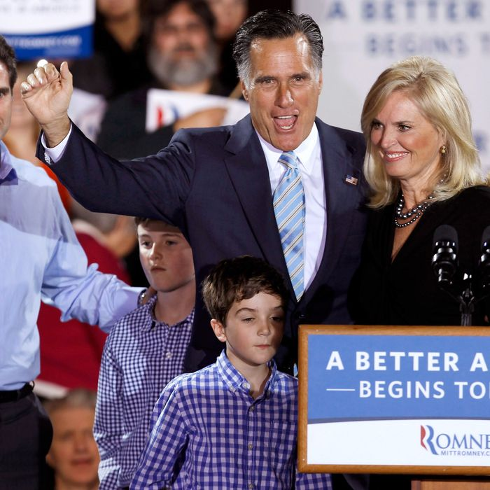 MANCHESTER, NH - APRIL 24: Republican presidential candidate, former Massachusetts Gov. Mitt Romney, his wife Ann Romney (R), his son Tagg Romney and some of his grandchildren wave to supporters during a campaign rally titled