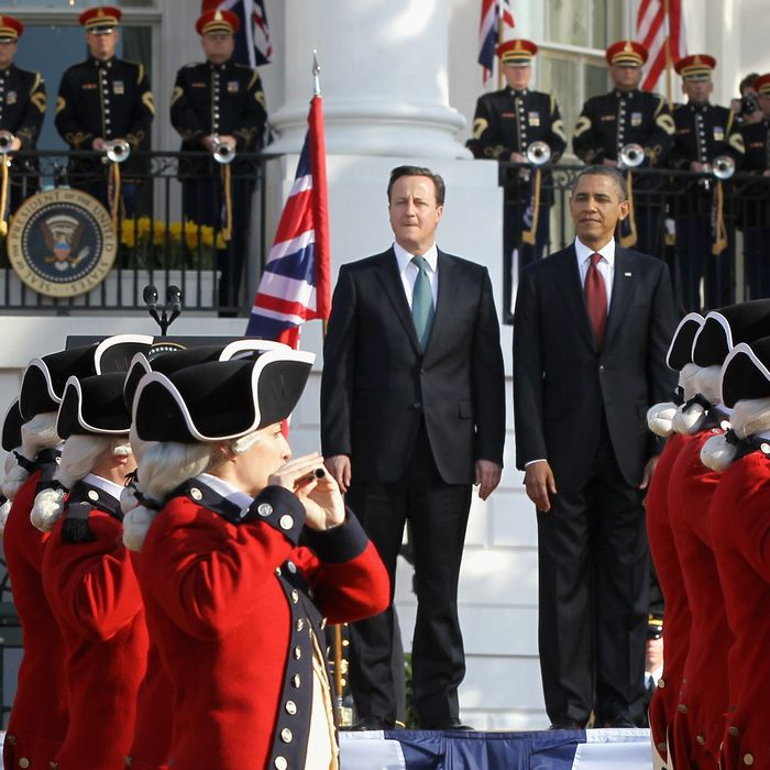 U.S. President Barack Obama (R) and British Prime Minister David Cameron review the U.S. Army's Old Guard Fife and Drum Corps during an official arrival ceremony on the South Lawn of the White House March 14, 2012 .