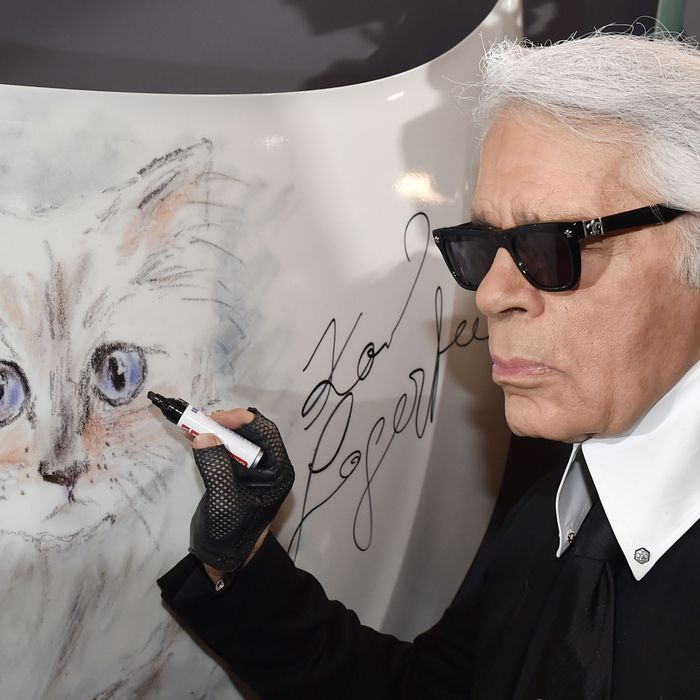 Karl Lagerfeld and a portrait of Choupette.