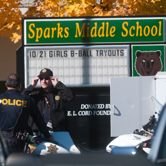 SPARKS, NV - OCTOBER 21:  Law enforcement gather in the parking lot after a shooting at Sparks Middle School October 21, 2013 in Sparks, Nevada. A staff member was killed and two students were injured after a student opened fire at the Nevada middle school. The suspected gunman was also killed. (Photo by David Calvert/Getty Images)