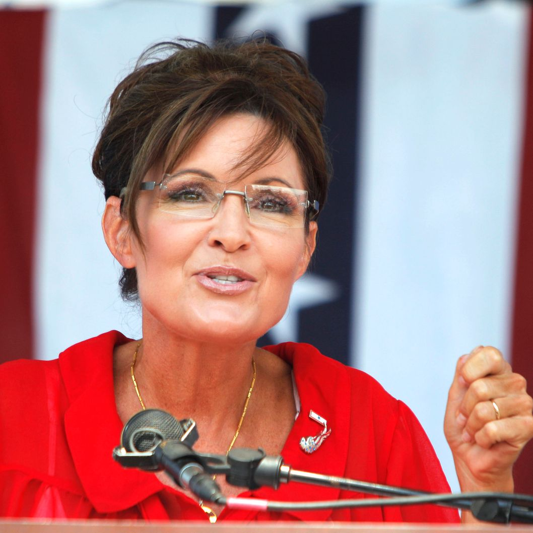 "Sarah Palin, former Governor of Alaska and 2008 Republican Vice Presidential candidate speaks at a ""Patriots in the Park"" Tea Party rally at the Wayne County Fairgrounds July 14, 2012 in Belleville, Michigan. The event was sponsored by Americans for Prosperity: Michigan and the Willow Run Tea Party Caucus."