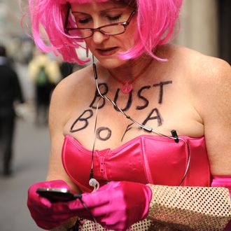 Jodie Evans wears a message on her chest as she protests Bank of America policies, part of International Women's Day demonstrations March 8, 2012 outside the Waldorf Astoria Hotel in New York. The Citi Finanical Services Conference was meeting inside the hotel and was featuring Bank of America CEO Brian Moynihan via teleconference. AFP PHOTO/Stan HONDA (Photo credit should read STAN HONDA/AFP/Getty Images)