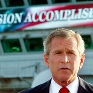 U.S. President George W. Bush declares an end to major combat in Iraq during a speech to crew aboard the aircraft carrier USS Abraham Lincoln as the carrier steamed toward San Diego, California, in this May 1, 2003 file photo.