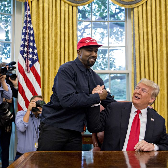 Rapper Kanye West, left, shakes hands with U.S. President Donald Trump during a meeting in the Oval Office of the White House in Washington, D.C., U.S., on Thursday, Oct. 11, 2018.