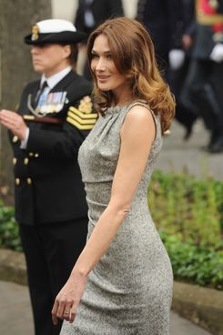 Carla Bruni-Sarkozy attends the wreath laying at the statue of Charles De Gaulle with her husband, President of the French Republic, Nicolas Sarkozy, on June 18, 2010 in London, England.