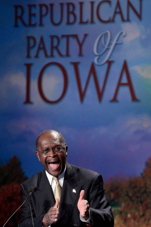 AMES, IA - AUGUST 13:  Republican presidential candidate and Georgia businessman Herman Cain addresses the program during the Iowa Straw Poll in the Hilton Coliseum at Iowa State University August 13, 2011 in Ames, Iowa. Nine GOP presidential candidates are competing for votes in the Iowa Straw Poll, an important step for gaining momentum in a crowded field of hopefuls.  (Photo by Chip Somodevilla/Getty Images)