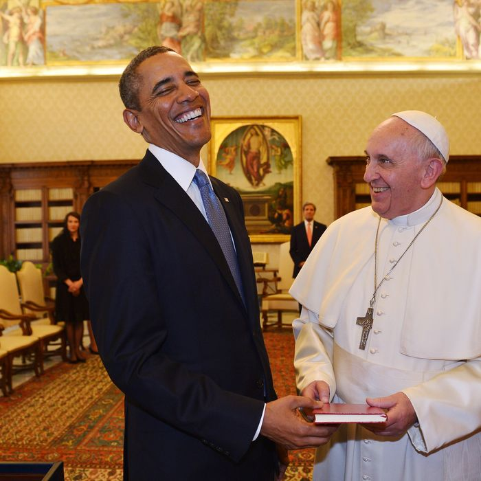Pope Francis (2ndR) and US President Barack Obama exchange gifts during a private audience on March 27, 2014 at the Vatican. The meeting at the Vatican comes as a welcome rest-stop for Obama during a six-day European tour dominated by the crisis over Crimea, and the US leader will doubtless be hoping some of the pope's overwhelming popularity will rub off on him.