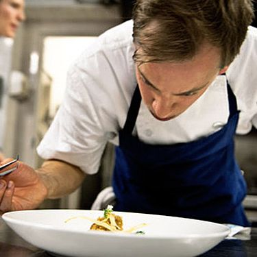 Hilbert plating a dish.