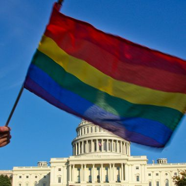 A demonstrator waves a rainbow flag in front of the US Capitol in Washington on October 11, 2009 as tens of thousands of gay activists marched to demand civil rights, a day after President Barack Obama vowed to repeal a ban on gays serving openly in the US military.        AFP PHOTO/Maria Belen PEREZ GABILONDO (Photo credit should read Maria Belen Perez Gabilondo/AFP/Getty Images)