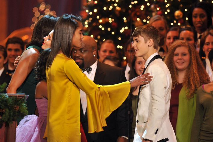 Malia Obama greets Justin Bieber onstage during Christmas in Washington 2011 at the National Building Museum on December 11, 2011 in Washington, DC.