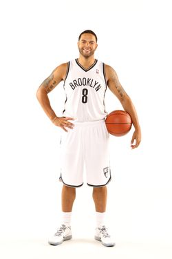 Deron Williams #8 of the Brooklyn Nets poses for a portrait during Media Day on October 1, 2012 at Barclay's Center in Brooklyn Borough of New York, New York.