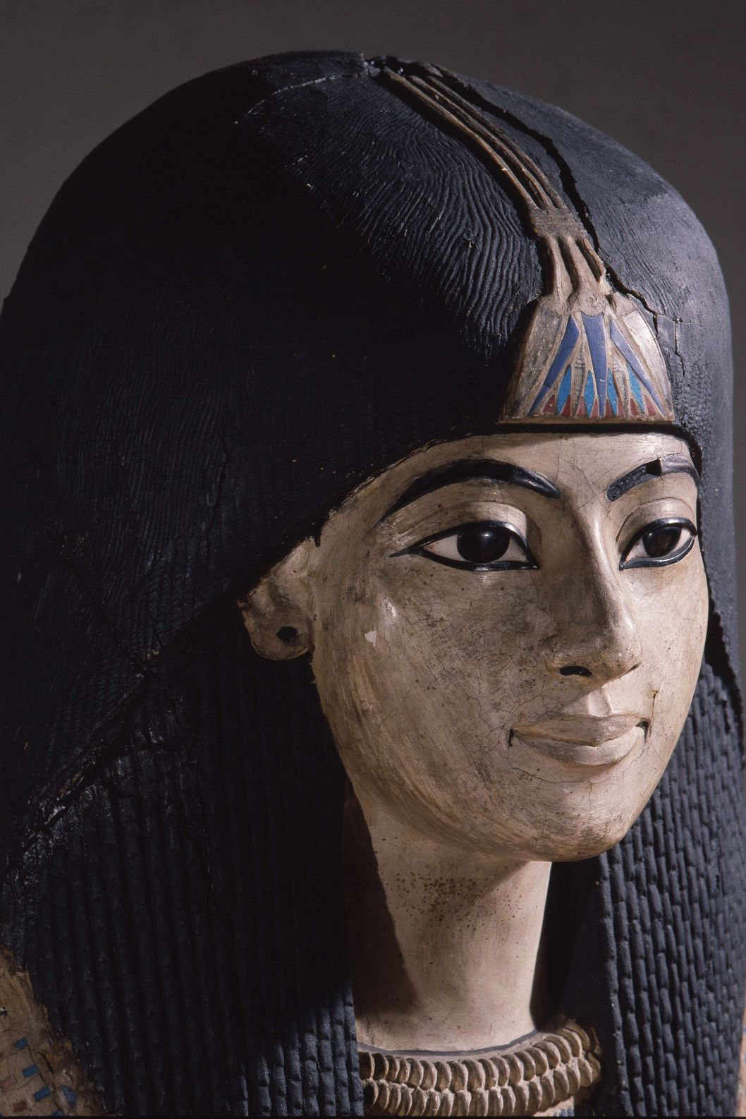 A mummy mask of a man wearing an elaborate collar and a heavy wig adorned with a lotus blossom, Egypt. Ancient Egyptian. 18th dynasty c 1550 1295 BC. (Photo by Werner Forman/Universal Images Group/Getty Images)