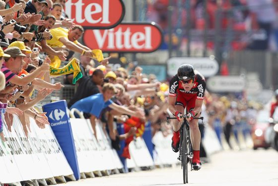 GRENOBLE, FRANCE - JULY 23:  Cadel Evans of Australia and BMC Racing Team heads for the finishing line and records the second fastest time to take over the race leaders yellow jersey after the Individual Time Trial Stage 20 of the 2011 Tour de France on July 23, 2011 in Grenoble, France.  (Photo by Michael Steele/Getty Images)