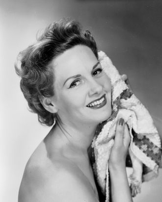 Woman with towel in vintage photo.