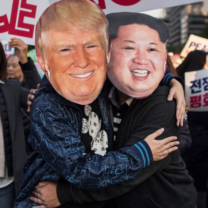 Demonstrators dressed as North Korean leader Kim Jong-Un (R) and US President Donald Trump (L) embrace during a peace rally in Seoul on November 5, 2017. (ED JONES/AFP/Getty Images)