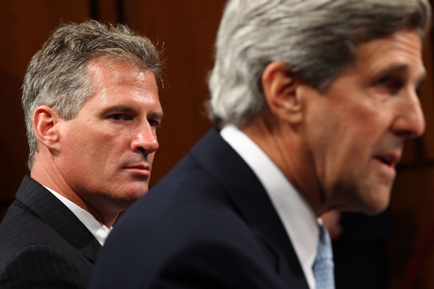 Sen. John Kerry (D-MA) (R) and Sen. Scott Brown (R-MA) (L) introduce Supreme Court nominee Elena Kagan to the Senate Judiciary Committee on the first day of her confirmation hearings on Capitol Hill on June 28, 2010 in Washington, DC.  Kagan is U.S. President Barack Obama's second Supreme Court nominee since taking office.