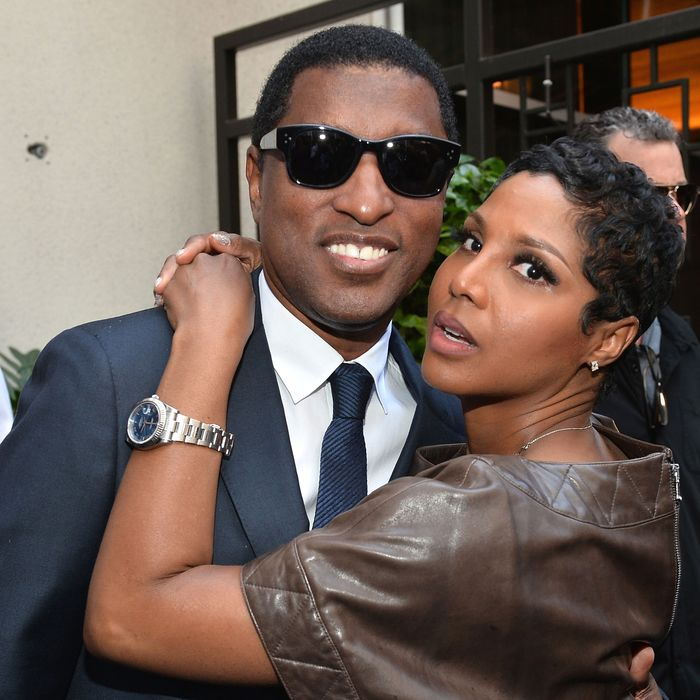 Singer Toni Braxton (r) and songwriter/record producer Kenny
