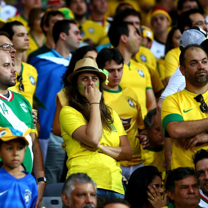 BELO HORIZONTE, BRAZIL - JULY 08: Brazil fans look dejected during the 2014 FIFA World Cup Brazil Semi Final match between Brazil and Germany at Estadio Mineirao on July 8, 2014 in Belo Horizonte, Brazil. (Photo by Michael Steele/Getty Images)
