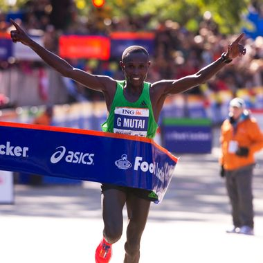 Geoffrey Mutai of Kenya crosses the finish line to win the ING New York City Marathon November 6, 2011 in New York. Mutai, the 2011 Boston Marathon winner, won the men's New York Marathon in an unofficial time of two hours, five minutes and five seconds to smash the course record on Sunday. Mutai smashed the old mark of 2:07:43 set by Ethiopia's Tesfaye Jifar in 2001 to defeat runner-up Emmanuel Mutai, the reigning London Marathon champion. AFP PHOTO/DON EMMERT (Photo credit should read DON EMMERT/AFP/Getty Images)