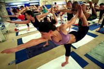 Students practice the unique Bikram Yoga at the City Studio