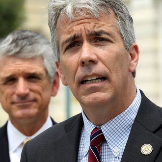 U.S. Rep. Joe Walsh (R-IL) (R) speaks as Rep. Scott Rigell (R-VA) (L) listens during a news conference to announce the formation of the 'Fix Congress Now Caucus' May 16, 2012 on Capitol Hill in Washington, DC.