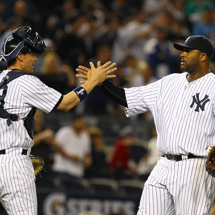 CC Sabathia #52 of the New York Yankees celebrates his complete game 6-2 victory against the Atlanta Braves with Chris Stewart #19 after their game on June 18, 2012 at Yankee Stadium in the Bronx borough of New York City.