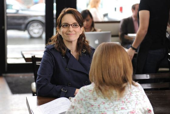 "30 ROCK -- ""Murphy Brown Lied to Us"" Episode 618 -- Pictured: (l-r) Tina Fey as Liz Lemon, Bebe Wood as Cat -- (Photo by: Ali Goldstei"