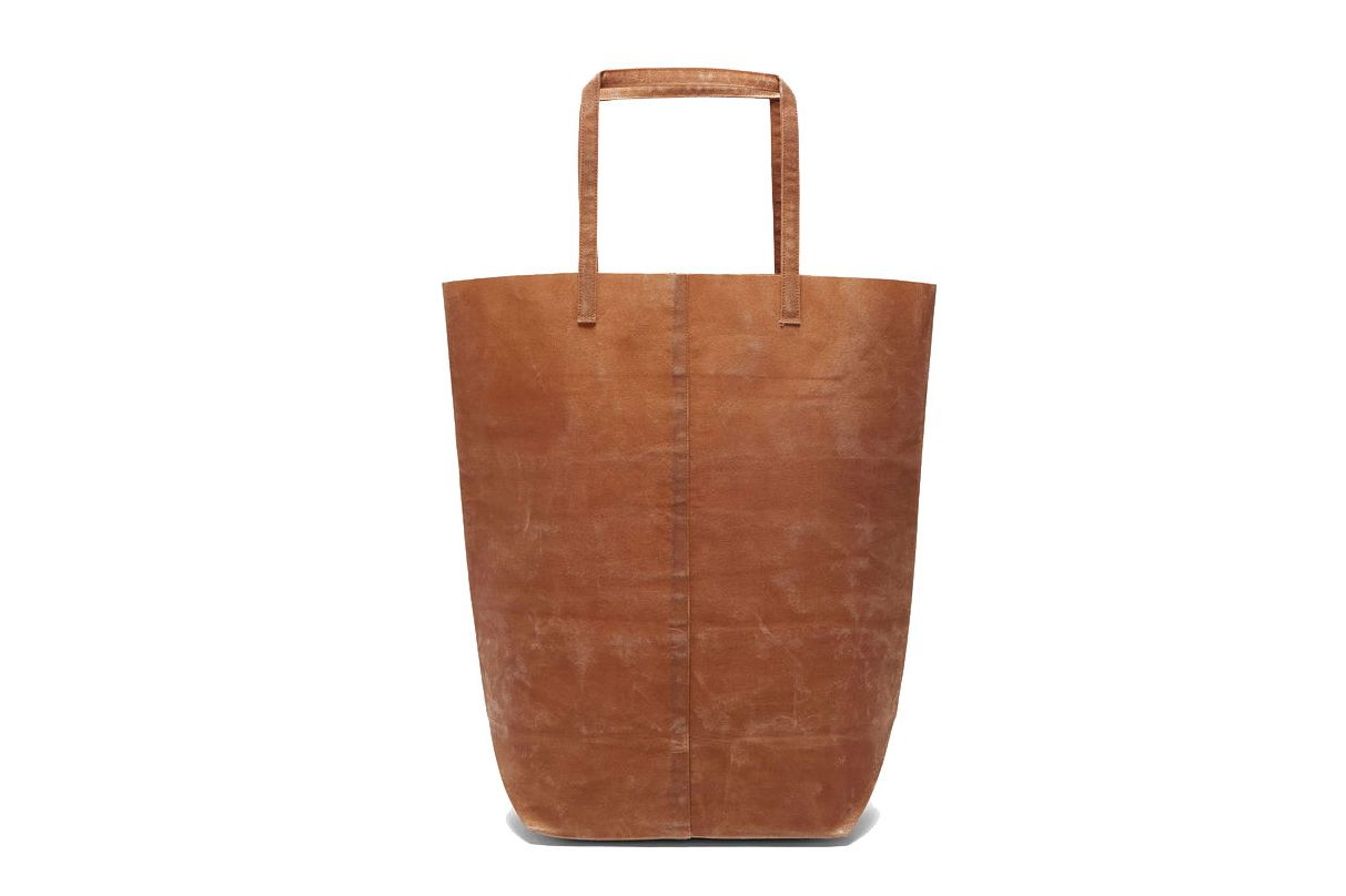 65ac58ae0d FUNAGATA UNISEX B WAXED CANVAS BAG IN BROWN. ""