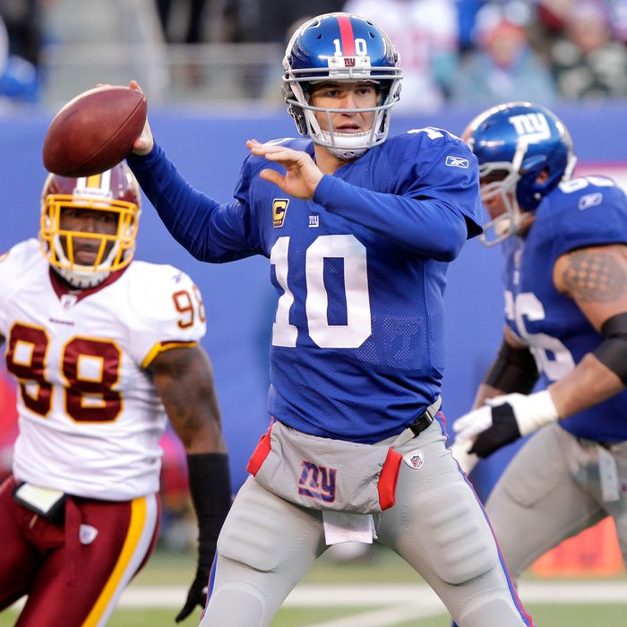 New York Giants Eli Manning gets set to throw a pass in the third quarter against the Washington Redskins in week 15 of the NFL season at MetLife Stadium in East Rutherford, New Jersey on December 18, 2011