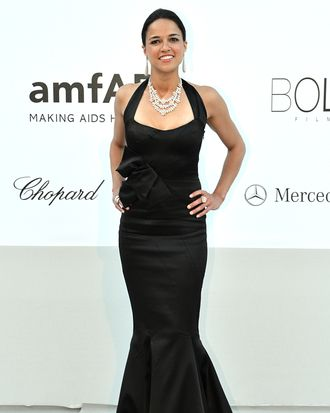 Actress Michelle Rodriguez poses as she arrives to attend the 2012 amfAR's Cinema Against Aids
