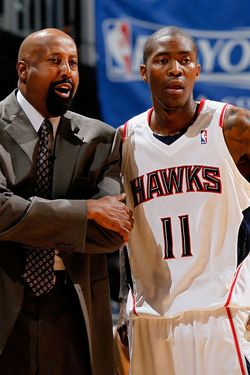 ATLANTA - MAY 10:  Head coach Mike Woodson and Jamal Crawford #11 of the Atlanta Hawks against the Orlando Magic during Game Four of the Eastern Conference Semifinals of the 2010 NBA Playoffs at Philips Arena on May 10, 2010 in Atlanta, Georgia.  NOTE TO USER: User expressly acknowledges and agrees that, by downloading and/or using this Photograph, User is consenting to the terms and conditions of the Getty Images License Agreement.  (Photo by Kevin C. Cox/Getty Images)