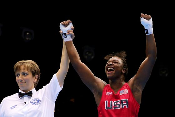 Referee Kheira Sidi Yakoub (L) announces Claressa Shields (R) of the United States winner over Nadezda Torlopova of Russia during the Women's Middle (75kg) Boxing final bout on Day 13 of the London 2012 Olympic Games at ExCeL on August 9, 2012 in London, England.