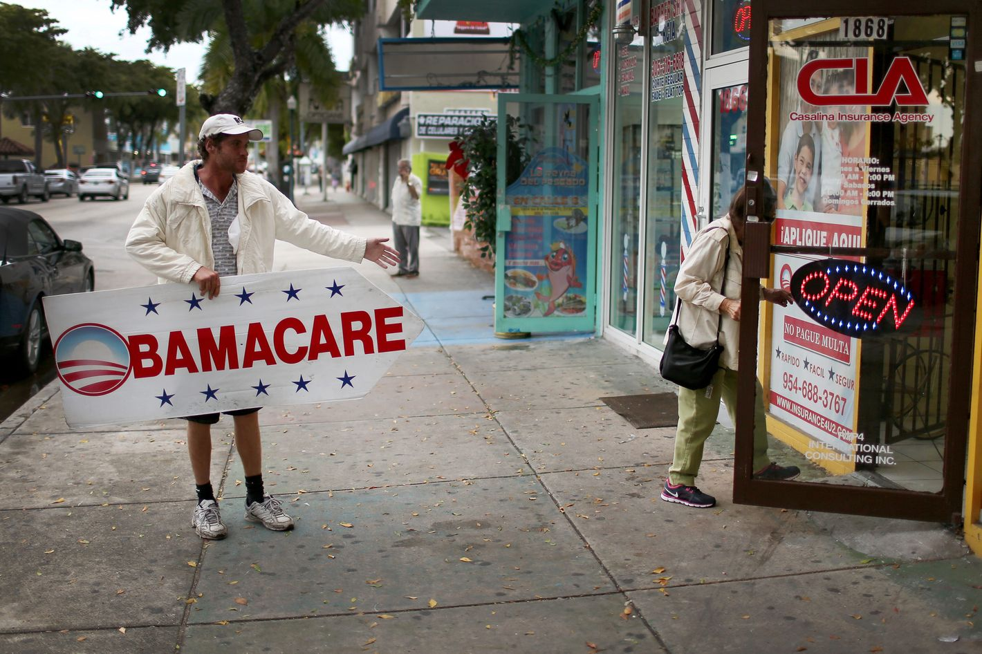 Pedro Rojas holds a sign directing people to an insurance company where they can sign up for the Affordable Care Act, also known as Obamacare, before the February 15th deadline on February 5, 2015 in Miami, Florida.