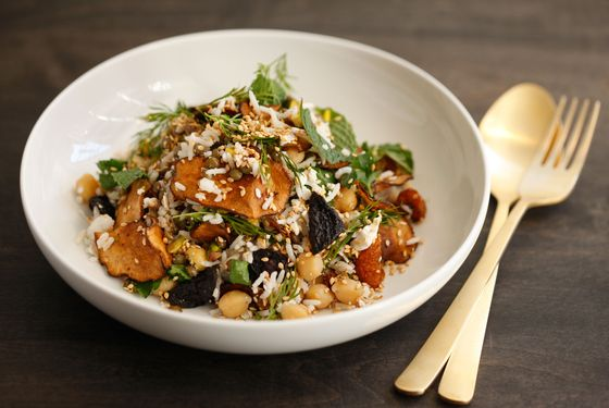 Lentils, basmati rice, and chickpeas with pistachios, rainbow carrots, ricotta salata, sunchoke chips, and herbs.